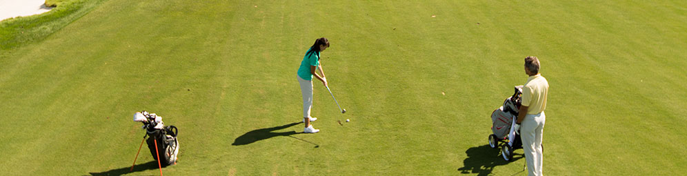 A woman playing golf on a golf course